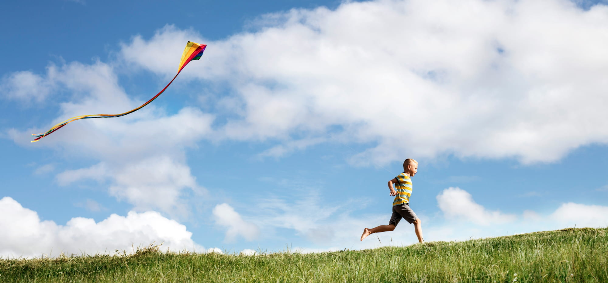 Kid running with kite