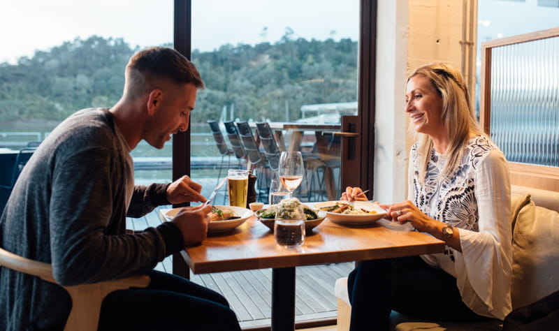 Couple in restaurant at Hobsonville Point